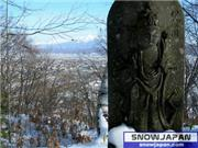 Statue of one of many gods with Furano town and mountains behind., uploaded by FuranoNow  [Furano, Furano City, Hokkaido]